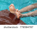 boy is swimming in pool with... | Shutterstock . vector #778584787
