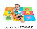 baby boy sitting over eva foam... | Shutterstock . vector #778616755