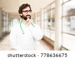 young doctor man thinking | Shutterstock . vector #778636675