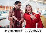 young couple buying in shopping ... | Shutterstock . vector #778648231