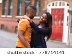 young couple showing affection | Shutterstock . vector #778714141
