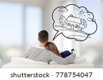 young couple sitting on sofa | Shutterstock . vector #778754047