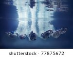 five swimmers jumping together...   Shutterstock . vector #77875672