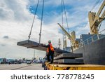 cargo steel slab discharging... | Shutterstock . vector #778778245
