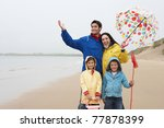 happy family on beach with... | Shutterstock . vector #77878399