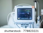 Stock photo medical vital signs monitor instrument in a hospital this health care device displays and monitors 778823221