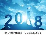 man hand up on the peak of... | Shutterstock . vector #778831531