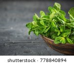 clay bowl with a bunch of fresh ... | Shutterstock . vector #778840894