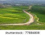 rural road through an... | Shutterstock . vector #77886808