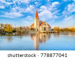 a church on the edge of a river ... | Shutterstock . vector #778877041