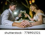 asian couple holding hands... | Shutterstock . vector #778901521