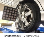 Small photo of Ipoh, Malaysia -December 18, 2017 : Car on tyres alignment. Tire alignment, also known as wheel alignment, can help your tires perform properly and help them last longer.