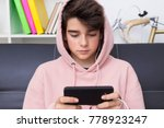 teenager or preteen with mobile ... | Shutterstock . vector #778923247