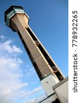 Small photo of air traffic control tower with blue sky