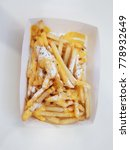 Small photo of French fries Chedda cheese ln white box delicious fast food