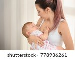 young mother lulling her baby... | Shutterstock . vector #778936261