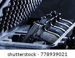 Black Handgun In Plastic Secur...