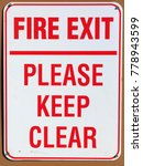 Small photo of Fire Exit Please Keep Clear Sign on a wall