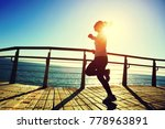 sporty female runner running on ... | Shutterstock . vector #778963891