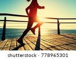 sporty fitness female runner... | Shutterstock . vector #778965301