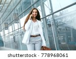 business woman with phone near... | Shutterstock . vector #778968061
