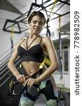 joyful girl stands in the gym... | Shutterstock . vector #778982509