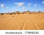 Traces of a vehicle in the Sahara desert, Egypt, Africa - stock photo