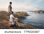 couple tourists with backpacks...   Shutterstock . vector #779020387