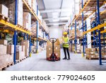 female warehouse worker loading ... | Shutterstock . vector #779024605