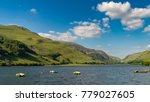 Small photo of Boats on the Tal-y-Llyn in South Snowdonia, Gwynedd, Wales, UK - with Cadair Idris in the background