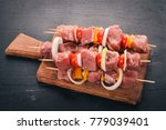 raw kebab from meat on a wooden ... | Shutterstock . vector #779039401