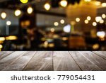 closeup top wood table with... | Shutterstock . vector #779054431
