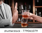 man rejecting glass of alcohol... | Shutterstock . vector #779061079