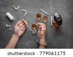 man in handcuffs with... | Shutterstock . vector #779061175