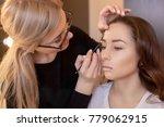 the make up artist paints... | Shutterstock . vector #779062915