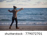girl dancing on the beach at... | Shutterstock . vector #779072701