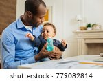baby bottle. caring young afro... | Shutterstock . vector #779082814