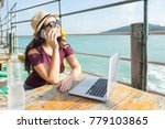 woman with laptop and bottle of ... | Shutterstock . vector #779103865