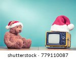 teddy bear toy watching retro... | Shutterstock . vector #779110087