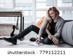 cheerful male composer is... | Shutterstock . vector #779112211