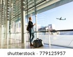 young casual female traveler at ... | Shutterstock . vector #779125957