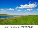 river and green grass - stock photo