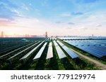 skyscrapers and solar panels ... | Shutterstock . vector #779129974