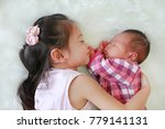 cute asian sister embracing... | Shutterstock . vector #779141131