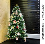 decorated christmas tree in the ... | Shutterstock . vector #779150329