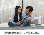 handsome man playing ukulele...   Shutterstock . vector #779160361