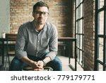 friendly man sitting at window... | Shutterstock . vector #779179771