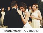 bride leans to groom's shoulder ...   Shutterstock . vector #779189047