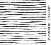 irregular black striped pattern.... | Shutterstock .eps vector #779194294