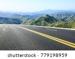empty asphalt highway in the... | Shutterstock . vector #779198959